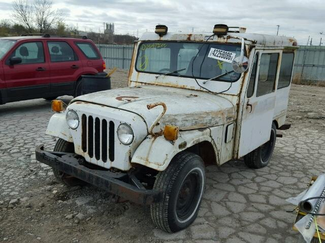 Outside front right side of car view - 1976 White Jeep Hard Top donated to Kars For Kids