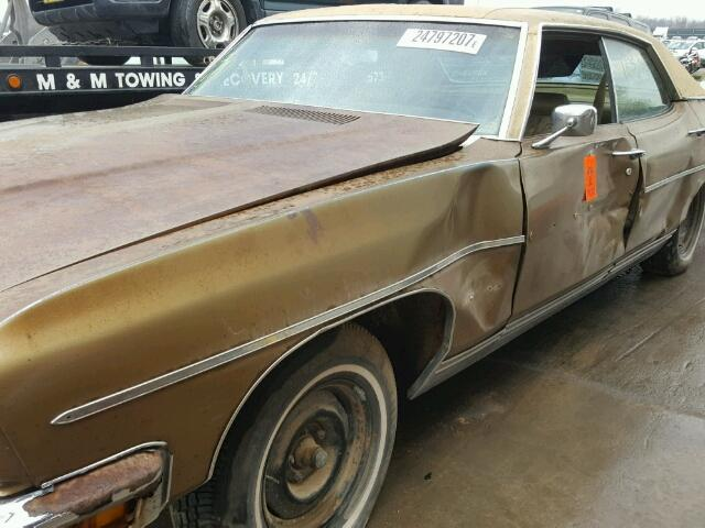 Outside front, right side of car view - 1970 Brown Pontiac Grand Bonneville donated to Kars For Kids