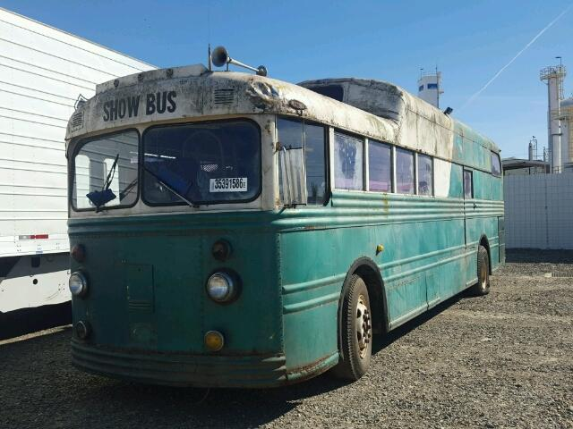 Outside front left side of bus view - 1950 Green Show Bus donated to Kars For Kids