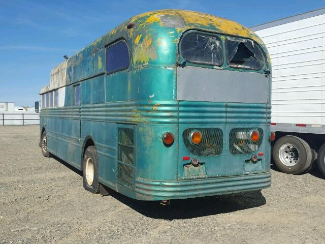 Outside back left side of bus view - 1950 Green Show Bus donated to Kars For Kids