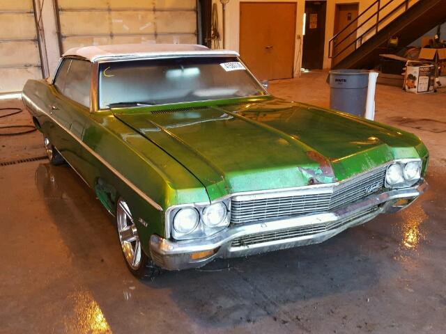 Outside front left side of car view - 1970 Green Chevy Impala donated to Kars For Kids