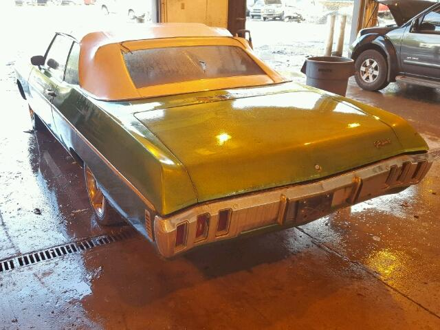 Outside back left side of car view - 1970 Green Chevy Impala donated to Kars For Kids