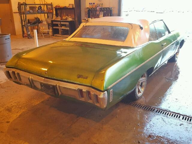 Outside back right side of car view - 1970 Green Chevy Impala donated to Kars For Kids