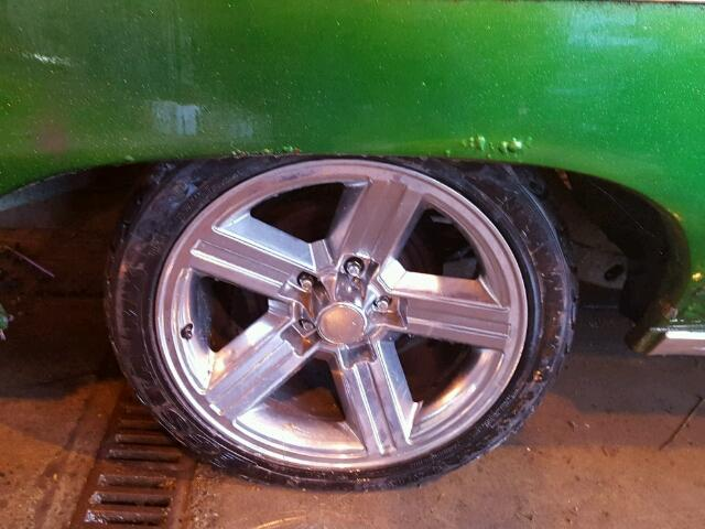 Outside back wheel view - 1970 Green Chevy Impala donated to Kars For Kids