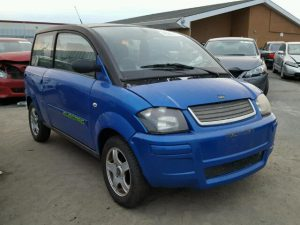 Outside front left side of car view - 2008 Blue Zenn Electric Car donated to Kars For Kids
