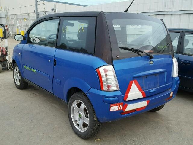 Outside back left side of car view - 2008 Blue Zenn Electric Car donated to Kars For Kids