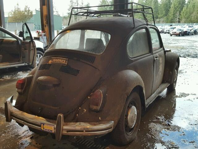 Outside back, right side of car view - 1970 Black Volkswagon Beetle donated to Kars For Kids