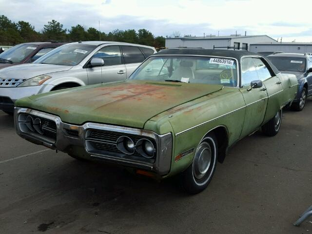 Outside front right side of car view - 1972 Green Plymouth Gran Fury donated to Kars For Kids