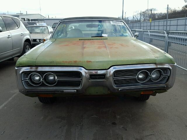 Outside front of car view - 1972 Green Plymouth Gran Fury donated to Kars For Kids