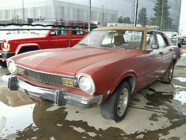 Outside front, left side of car view - 1973 Red Ford Maverick donated to Kars For Kids