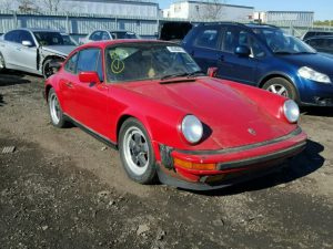 Outside front, right side of car view - 1986 Red Porsche 911 Carrer donated to Kars For Kids