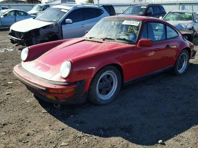 Outside front, left side of car view - 1986 Red Porsche 911 Carrer donated to Kars For Kids