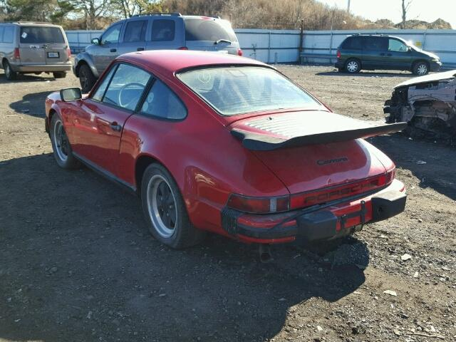 Outside back, left side of car view - 1986 Red Porsche 911 Carrer donated to Kars For Kids