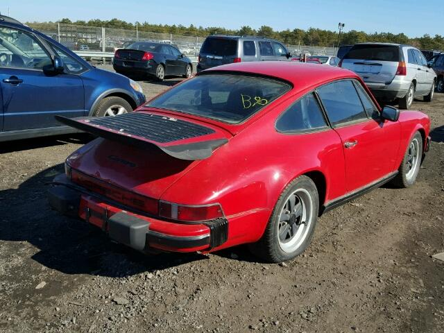 Outside back, right side of car view - 1986 Red Porsche 911 Carrer donated to Kars For Kids