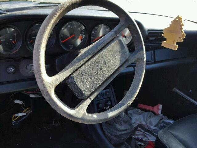 Inside steering wheel view - 1986 Red Porsche 911 Carrer donated to Kars For Kids
