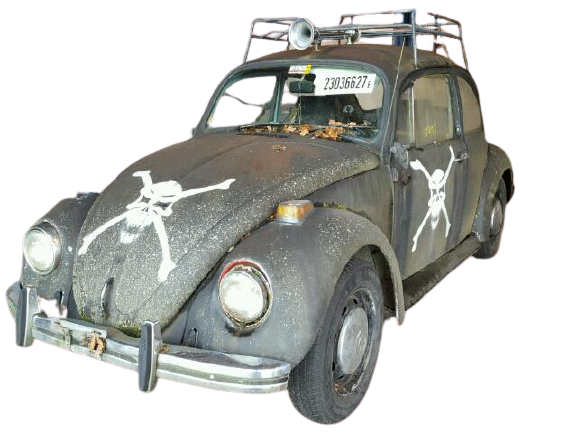 A classic Beatle car with a skull drawn on it