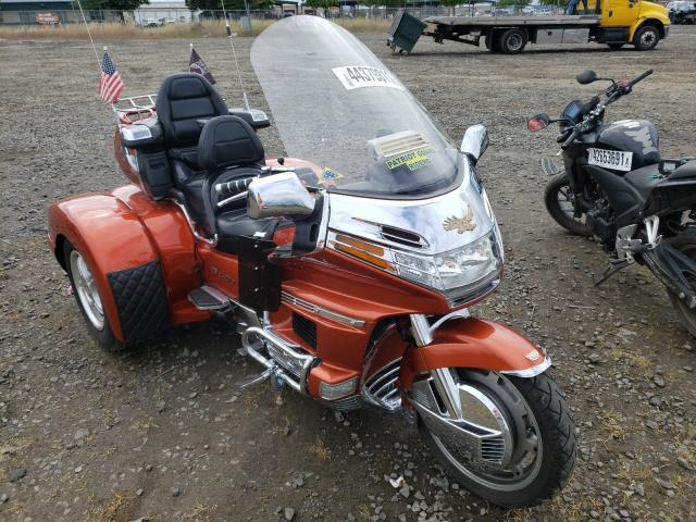 1997 Honda Motorcycle Orange  - front right view